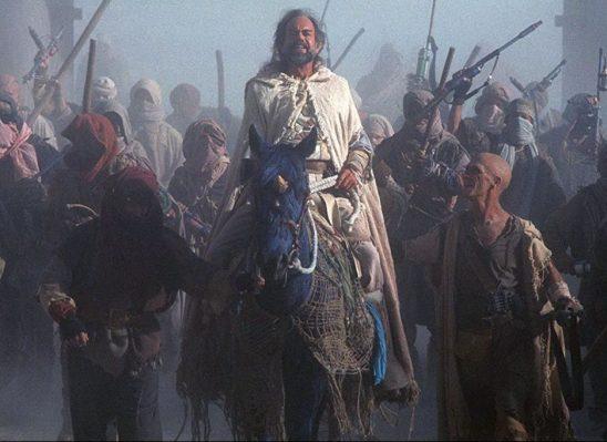Sybok leading his followers on horseback.