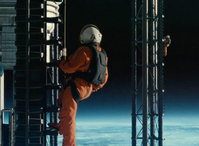 Two astronauts on a tower in space.