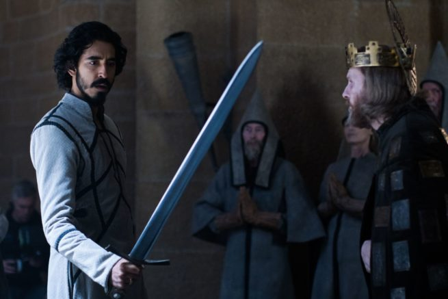 Dev Patel holding a sword in The Green Knight